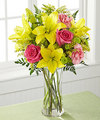 Light, lovely, and set to surprise and delight your recipient with its bright blooms, this flower bouquet speaks to the magic that each day holds. Brilliant yellow Asiatic Lilies are surrounded by hot pink roses, pink carnations, yellow solidago, and lush greens, beautifully arranged in a classic clear glass vase to create a gift that exudes warmth and happiness. A wonderful way to celebrate a birthday, or express your thank you, or congratulations wishes!