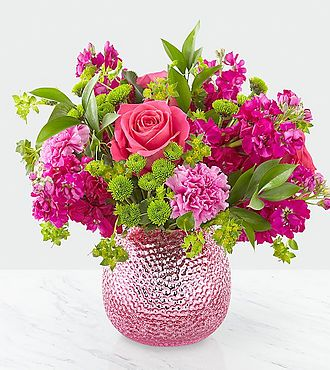 Purple vase of pretty mixed color flowers